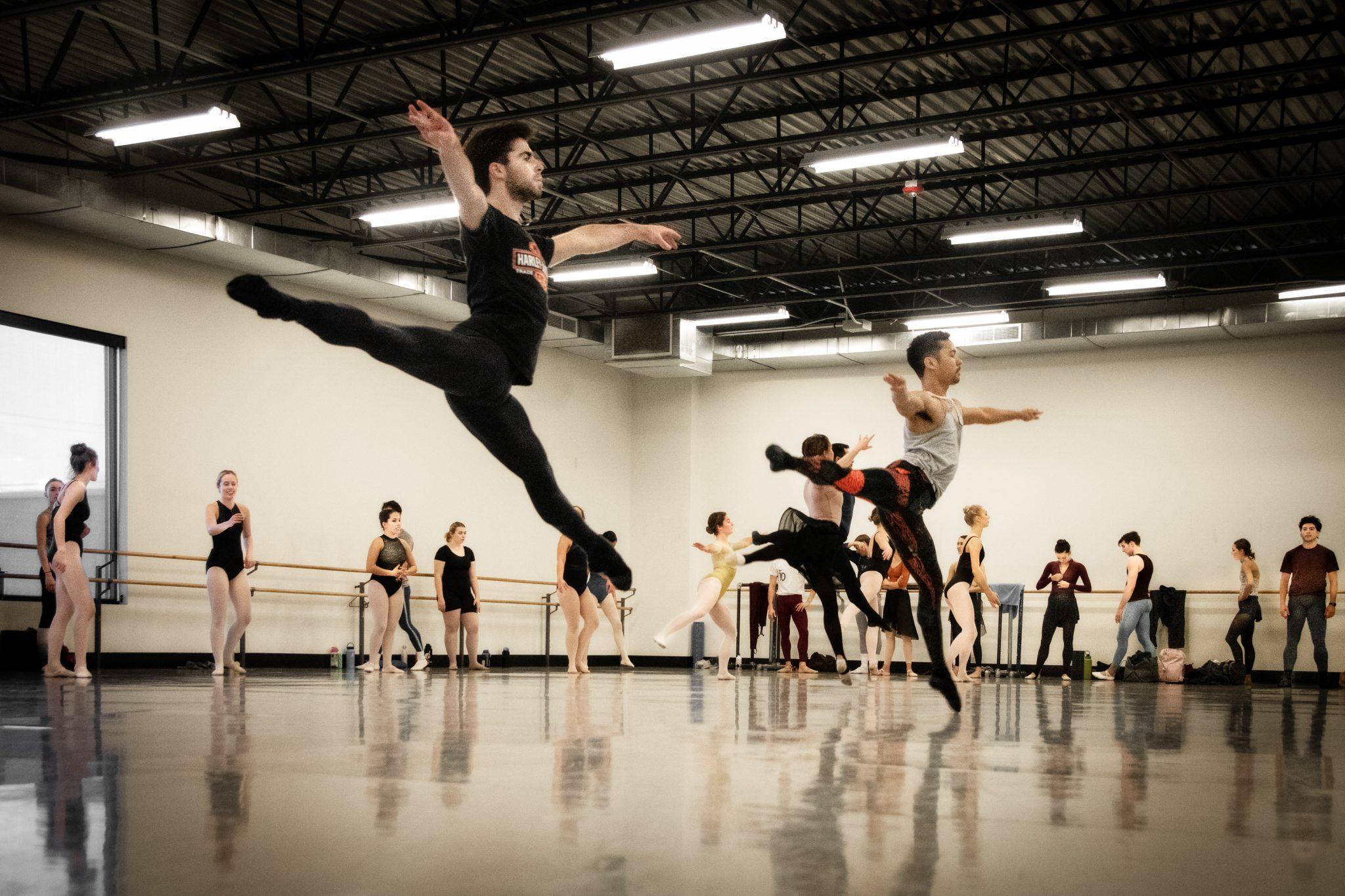 Ballet dancers practice in studio