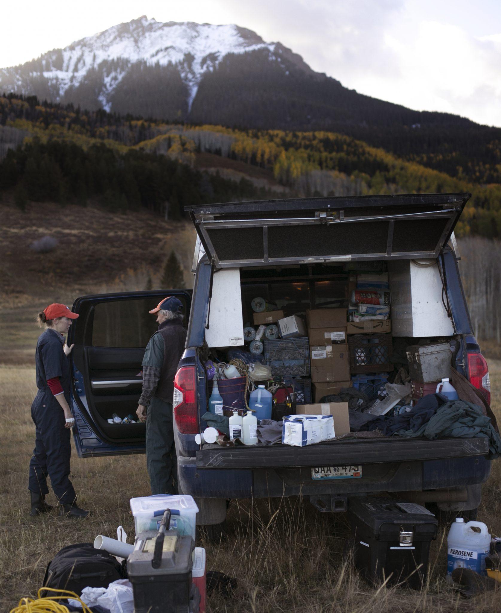 Laurel Sundberg and Tim Holt confer in a mobile vet unit