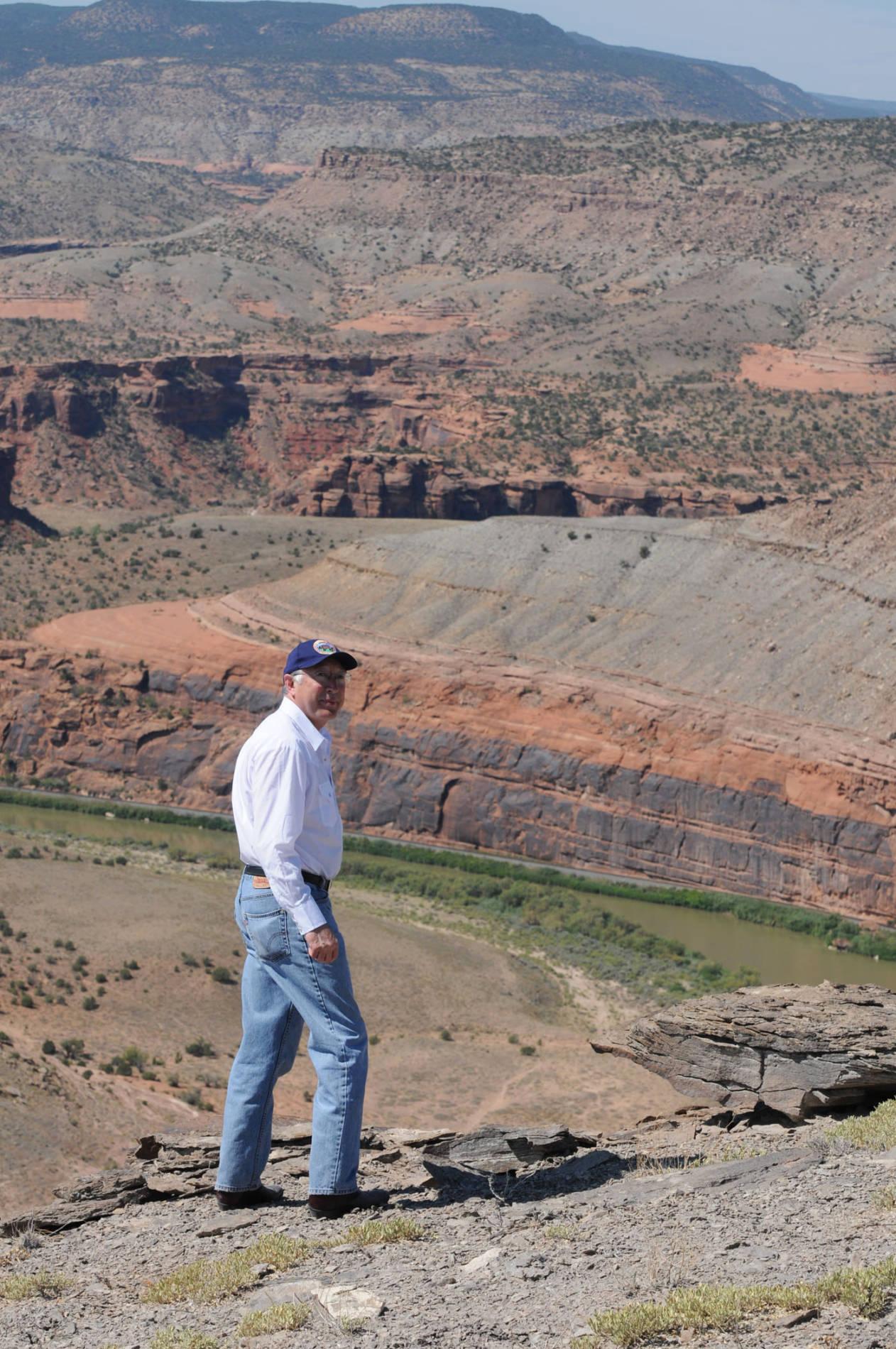 Ken Salazar overlooking a river in western Colorado