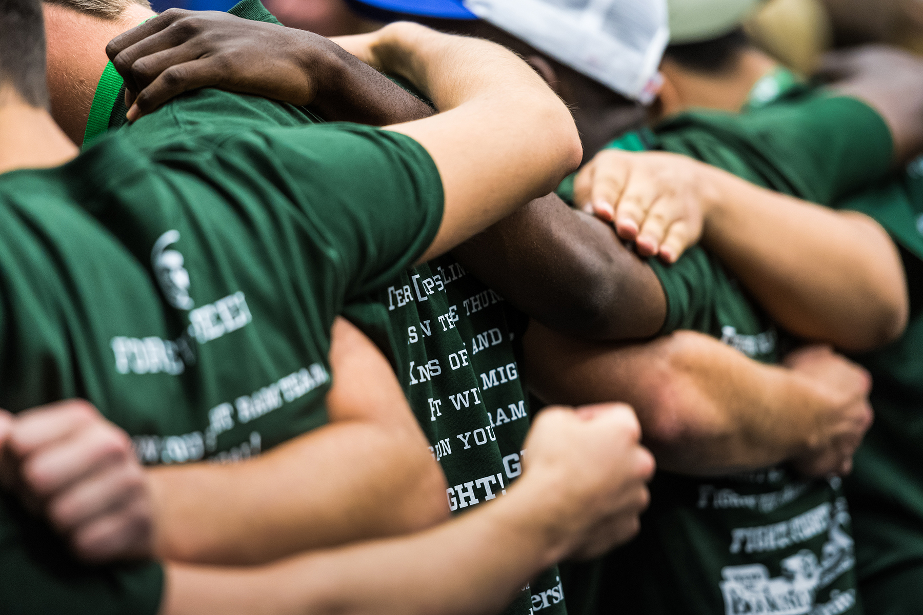 students gather and embrace during freshmen orientation